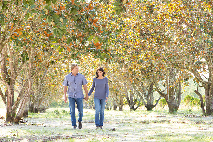 Matt & Julie Walking in Magnolia Tree Grove